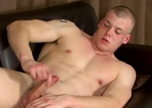 Muscled straight guy Jake Smith arrives for a solo wanking video and jerks out a load!