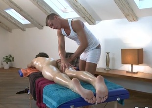 Sexy hunk is getting his tabulation sucked by gay masseur