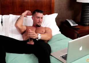 Attractive boy with a muscled body pleases his long prick on chum around with annoy bed