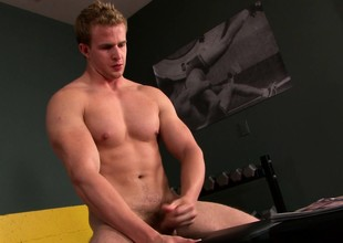 Attractive stud Cameron Foster loves yon drive his heavy stick yon orgasm