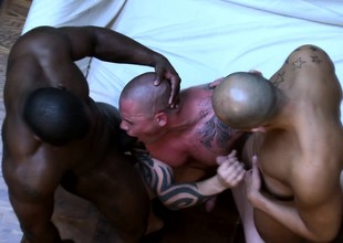 Tattooed gay stud introduces mortal physically beside a wild interracial threesome