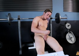Muscled gym rat Chris flexes his muscles while masturbating in be passed on weight room