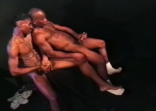 Two black guys with ripped men trample depart their dicks and cum together