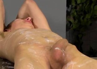 Wax covered twink gets his cock jerked off