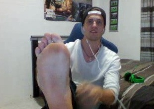 Cool austrl. guy showing off his large soles