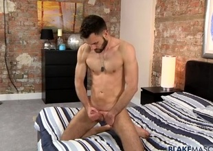 Hot solo guy with a beard jerks off erotically