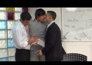 Three lovely hunks fucks bareback in office.