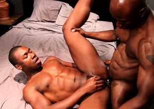 Louring skinned gay lovers indulging in exciting anal action on the bed