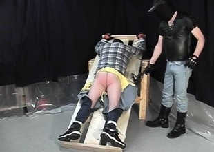 Gay Russel is tied up increased by gets gloved fingers probing his asshole