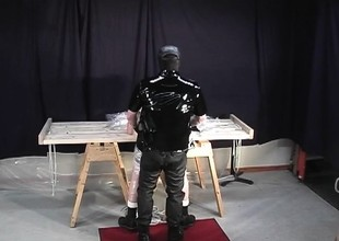 Sadistic old hand wraps up his slave in cellophane as he makes him drag inflate