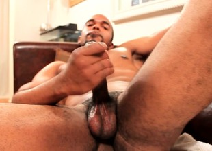 Dazzling ebony guy with a ripsnorting fabrication drives his long dick here orgasm