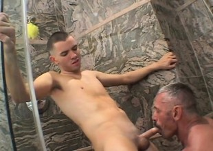 Hung stud Spike Morrison pounds a young guy's tight ass in the shower
