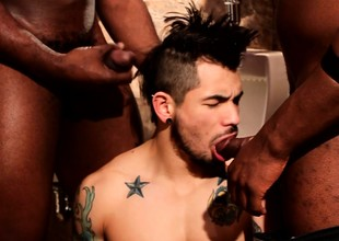 Tattooed white scantling gets his mouth and ass pounded fast overwrought two black cocks