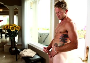 Hot blond Kody Slater shows gone his muscled torso to the fullest extent a finally masturbating
