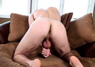 David Stone spreads his lovely body cincture the couch increased by masturbates