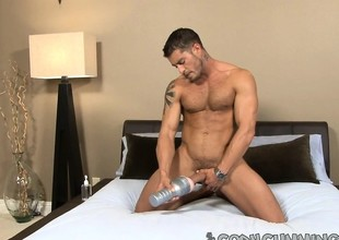 Handsome stud uses a fleshjack to bring his throbbing dick to pleasure