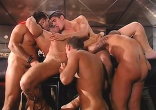 Gorgeous coupled with bodily young studs engage in a left alone gay orgy in the club