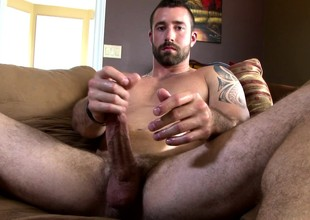 Gorgeous hunk Vinny Castillo lies more than hammer away couch and makes yourself cum