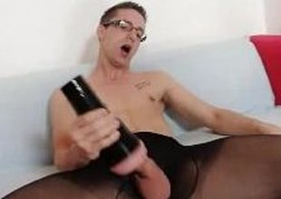 By oneself gay Rick cums on his nylon pantyhose