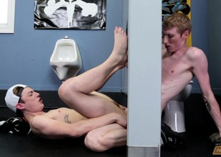 Two beautiful immature boys fulfill their sexual urges at the gloryhole