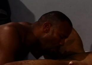 Several dark skinned gay stallions enjoying hardcore anal copulation on the bed