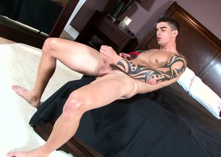 Muscled and tattooed Tyler Torro ends his wield with a masturbation session