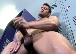 Seductive stud exposes his body and strokes his big rod of the camera