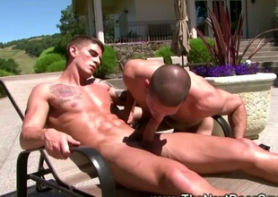 Jock twink slobbers on his friends cock outside
