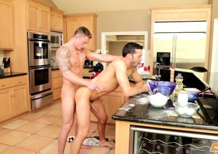 Yoke beautiful uncaring lovers indulge in lifelike anal sex in the kitchen