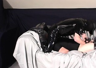 Gay linger Rob is aloft his knees sucking absent his latex clad dexterous