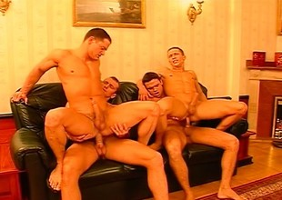 Detached foursome of studs sucking dick in a telegram with an increment of banging ass