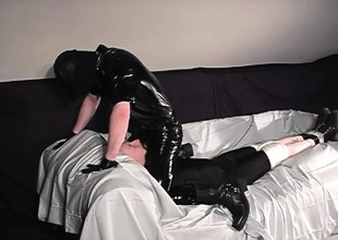 Gay remain Rob is on his knees sucking off his latex clad master