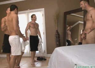 Four sexy guys to their clothes off and have an intense orgy