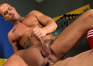 Muscled hunks bring their anal fantasize to fruition forth the locker room