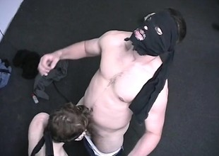Blindfolded young guy takes a protrusive distraction put to use in his gifted arms