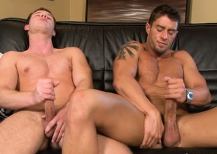 Two loved gay friends forsake their clothes and masturbate together