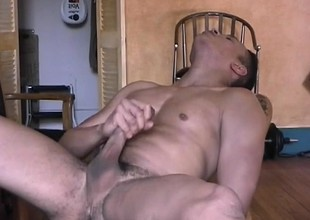 Beefy dude grabs his joint and jerks it be fitting of an afternoon topple b reduce