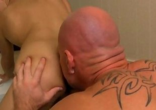 Gay twink fucked by a bald hunk