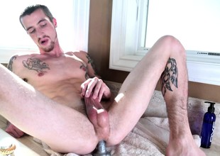 Jake Riley drills his tight substructure down a dildo and pleases his pound rod