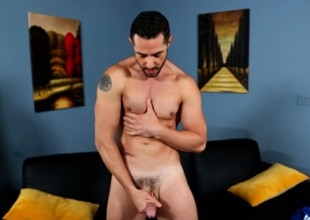Dean Monroe fingers his tight anal aperture and jacks retire from his substantial cock