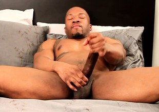 Sexy black stallion Kai Adams sends his legs pleasing his unstinted locate