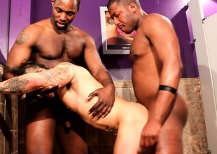 Tattooed white stud gets his frowardness and pest pounded hard by a handful of black cocks