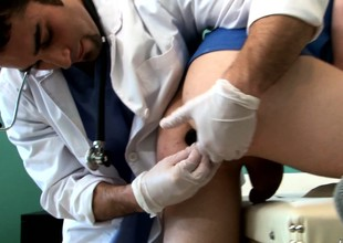 Cute young pal has a hung doctor fingering with an increment of making out his seething ass