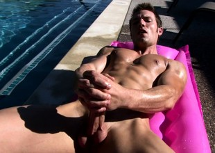 Sunbathing stud Kevin Crows massages his body and jerks off his shaft