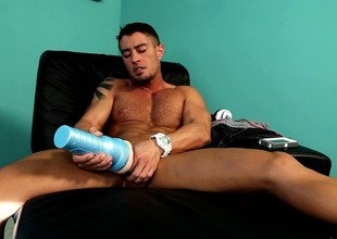 Muscled ray pleases his cock in the air his left side and a fleshlight